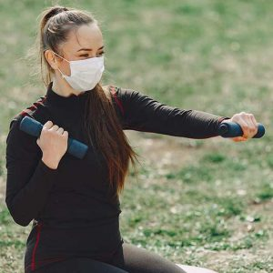 Girl exercising during covid 19.