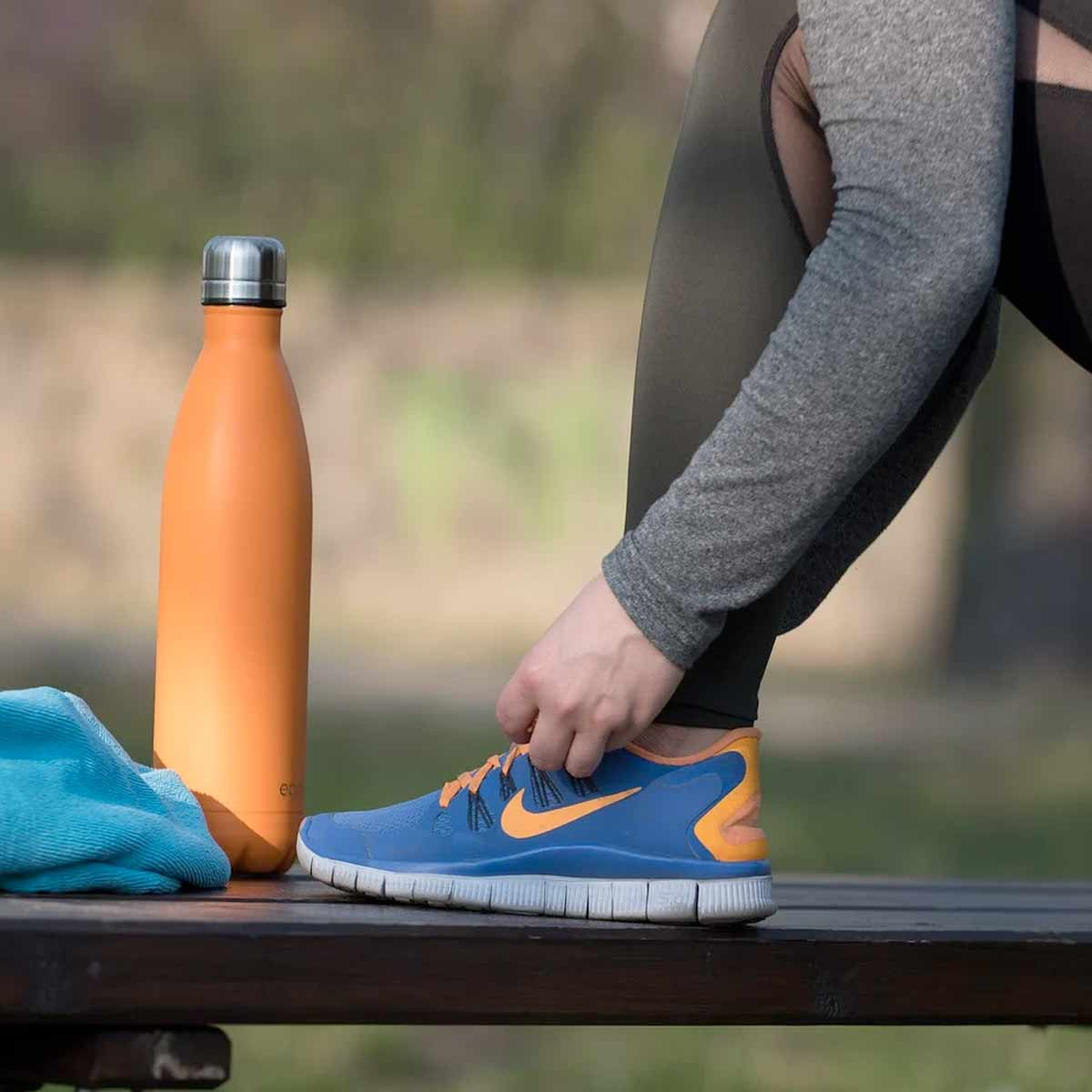 Women ready for exercise and tying her shoelaces - Weight loss myths